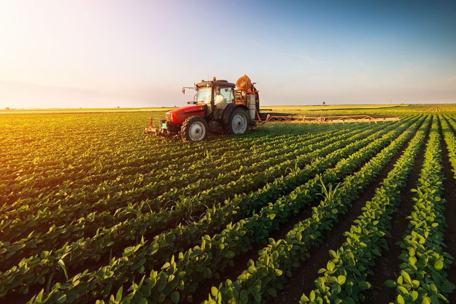 Agribusiness Insurance - Farm Machinery in a Field