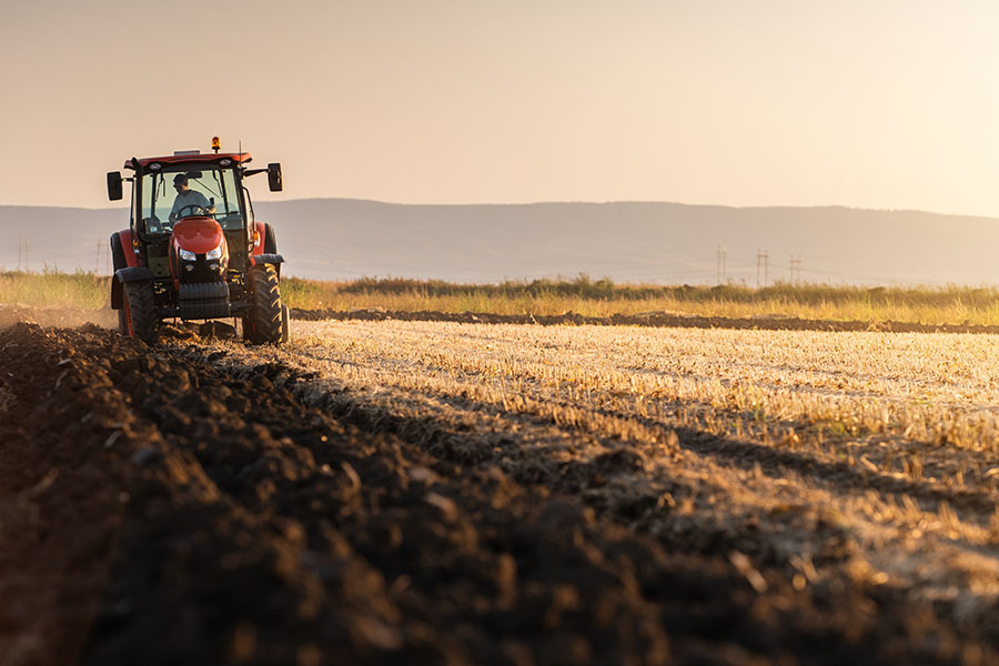 Insurance Quote - View of Farm Tractor Planting New Crops in Field